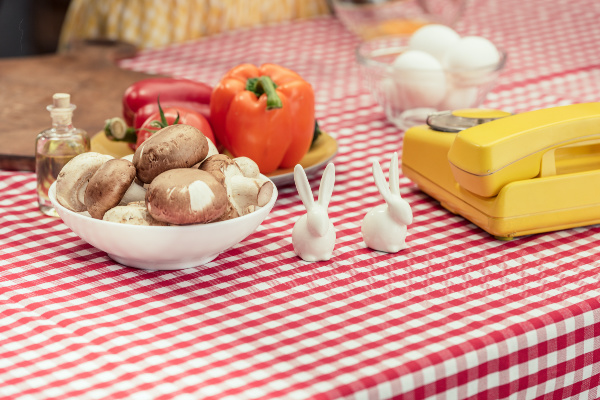 red check table cloth, veggies, bunny salt and pepper shakers and a vintage phone