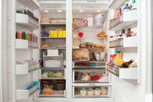 open fridge and freezer full of food