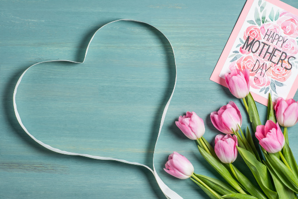 aqua table with ribbon heart, pink tulips and a Mother's Day card