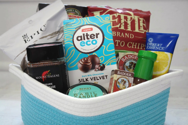 blue and white basket with snacks and other gifts for men