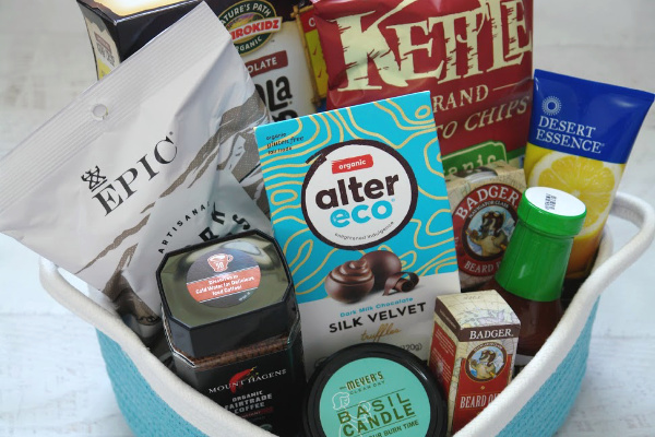 blue and white basket with snacks and other gifts for men up close