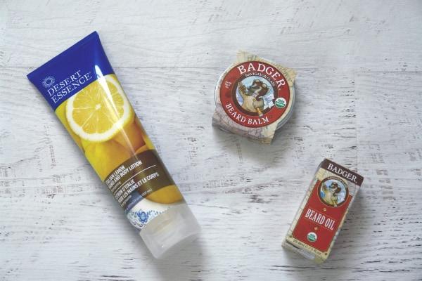 lotion, beard balm and beard oil on white table