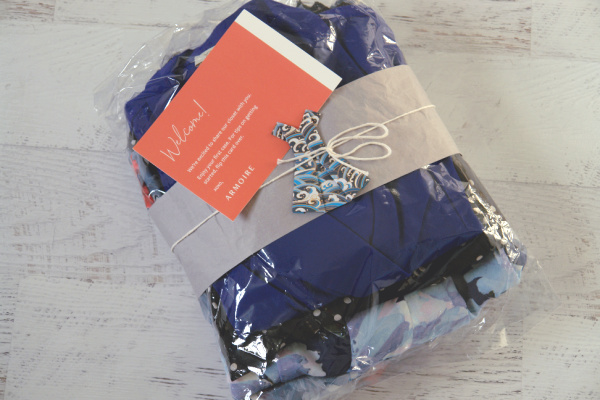 Armoire clothes in wrapping with welcome note