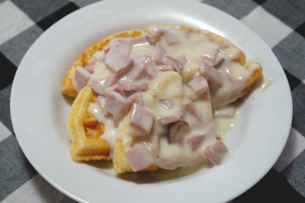 waffles on plate with creamed ham