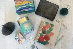 Erin Condren gifts on wooden table