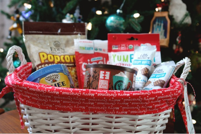 popcorn making supplies and snacks in basket in front of christmas tree