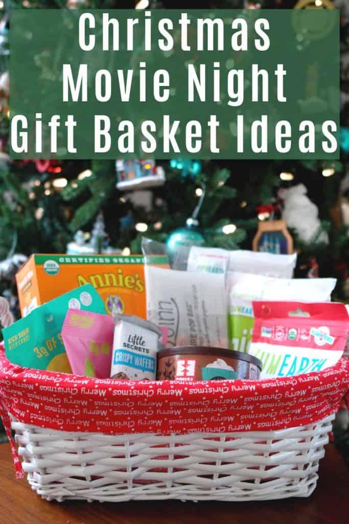 christmas gift basket full of snacks in front of Christmas tree