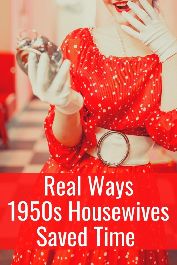 1950s housewife in red dress with white polka dots holding vintage clock