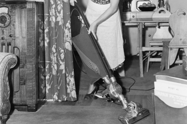 woman vacuuming in black and white