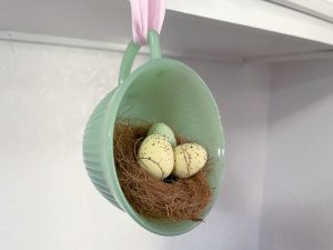 Jadeite teacup with bird nest tied with pink ribbon