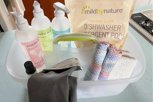 cleaning caddy full of natural cleaning products