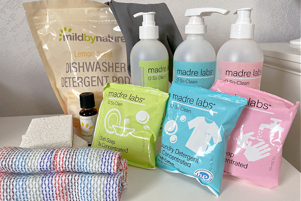 natural cleaning products from iHerb for spring cleaning tips on white countertop