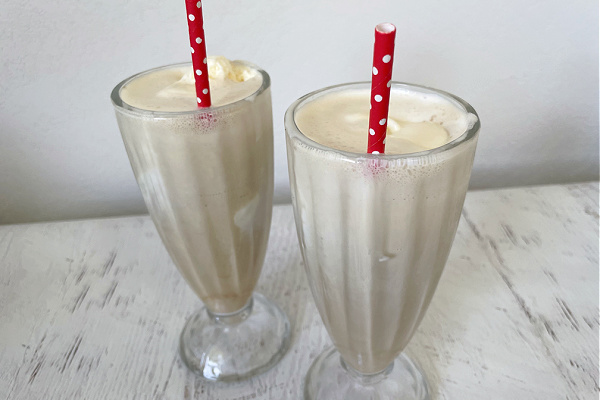 coffee floats on table with red straws