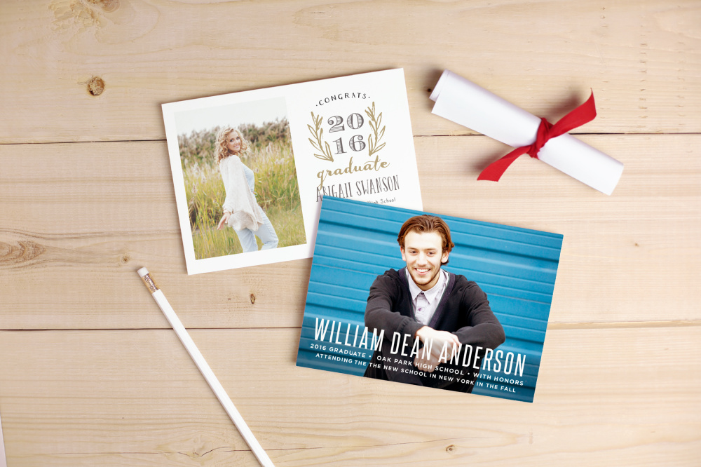 two graduation announcements on table