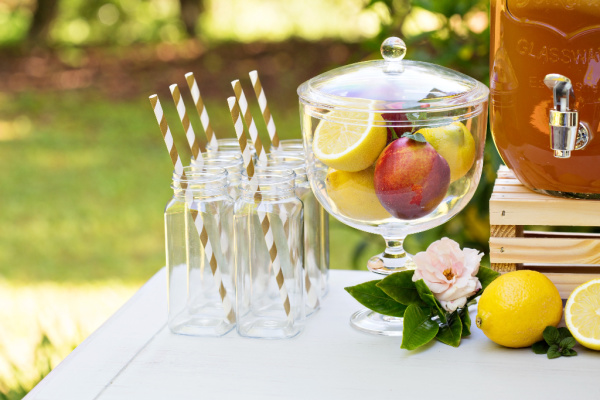 table outside with glasses and drink dispensers